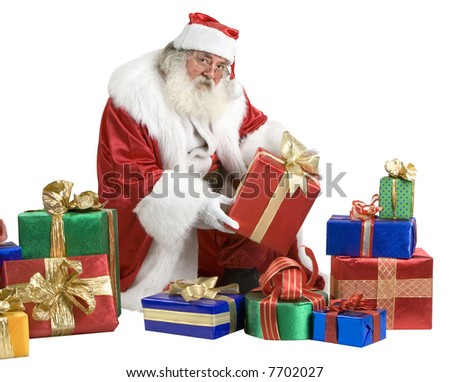 A real Santa Claus portrait taken at the South Pole showing presents - stock photo