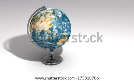 A realistic globe on a chrome pedestal over white featuring Asia.  Some elements of this image furnished by NASA.