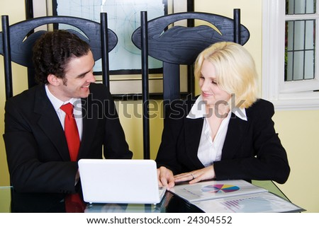 a realtor meets with a client at home - stock photo