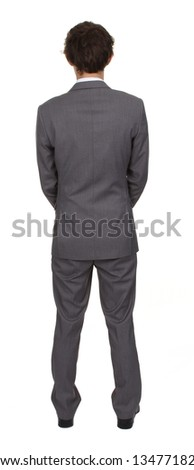 A rear view of a businessman, isolated on white.