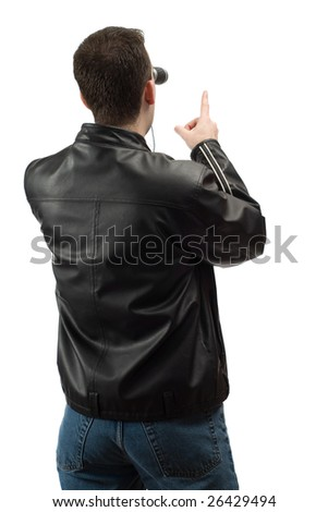 A rear view of a spectator wearing a leather jacket, and pointing at something, isolated against a white background - stock photo
