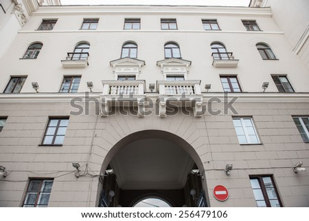 A rebuilt historical building on Independence Square in Minsk with the finest architecture. Small yet beautifully structured balconies look splendid, enhancing the beauty of the house. - stock photo