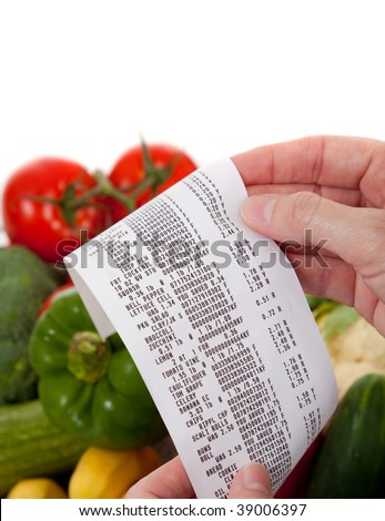 A Receipt over bag full of vegetables - stock photo