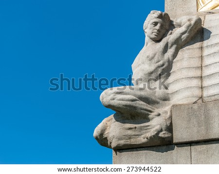A reclining figure on a memorial in Liverpool to mark the Titanic. - stock photo