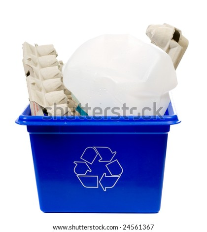 A recycling box filled with egg containers and a milk jug, isolated against a white background - stock photo
