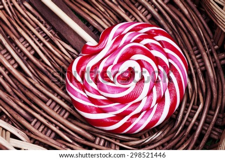 a red and white large spiral lollipop - stock photo