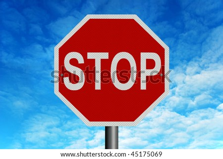 A red and white reflective 'Stop' sign in front of a bright blue summer sky - stock photo