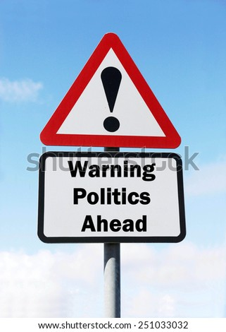A red and white triangular road sign with a warning about politics ahead concept against a partly cloudy sky.conditions.  - stock photo