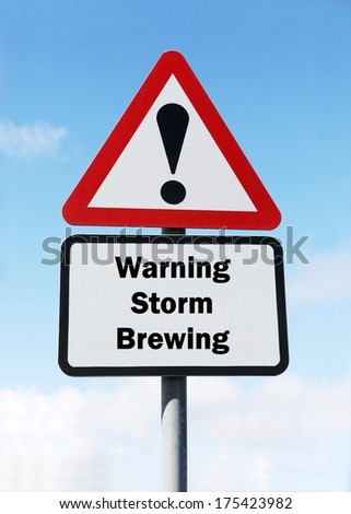 A red and white warning roadsign with a Storm Brewing ahead concept. against a partly cloudy sky background