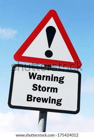 A red and white warning roadsign with a Storm Brewing ahead concept. against a partly cloudy sky background - stock photo
