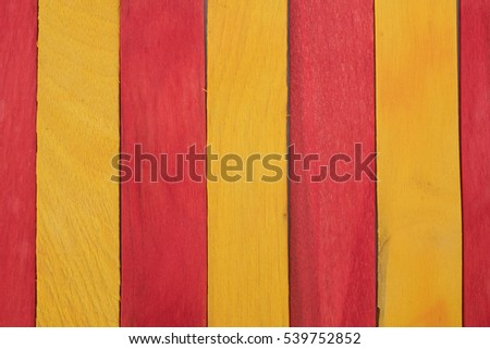 A red and yellow wooden panel