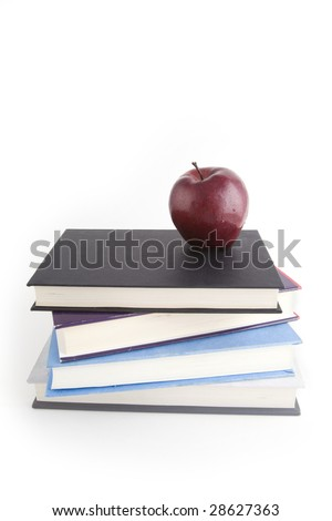 A red apple on a white background on top of a pile of books