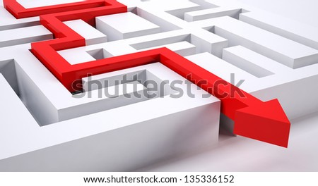 a red arrow making the right decision through a puzzle - stock photo