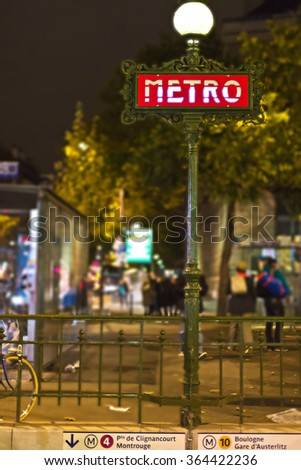 A red art-deco metro sign in Paris at night - stock photo