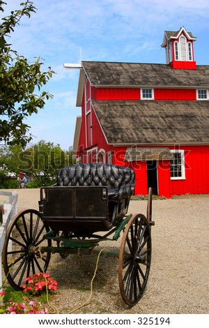 A red bar and buggy at a farm in Southern California. - stock photo