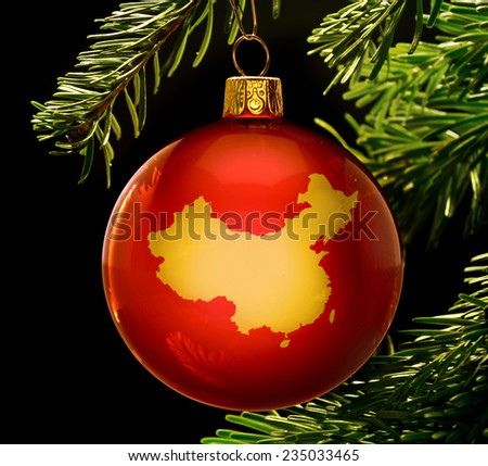A red bauble with the golden shape of  China hanging on a christmas tree isolated on black.(series)