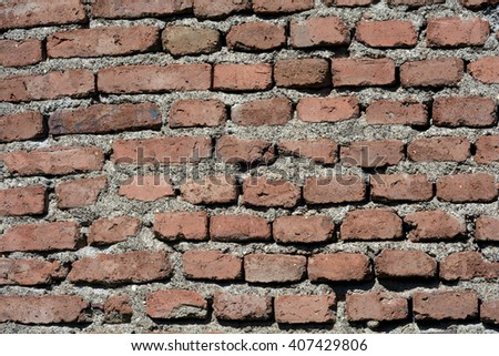 A red brick wall background - stock photo