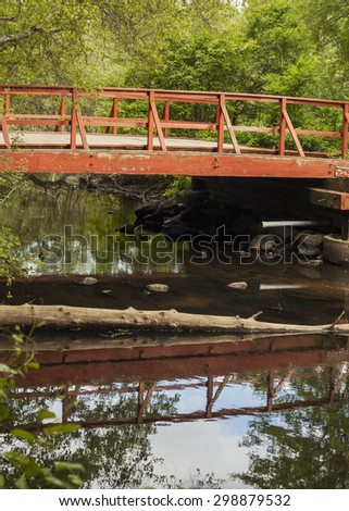 A Red bridge over small river, Horn pond, America - stock photo
