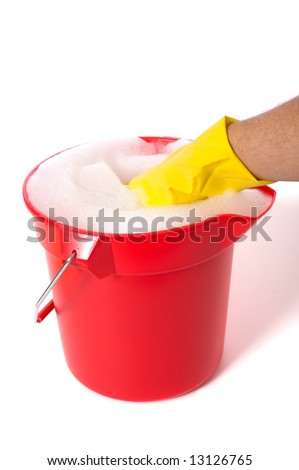 A red bucket full of soapy water on a white background