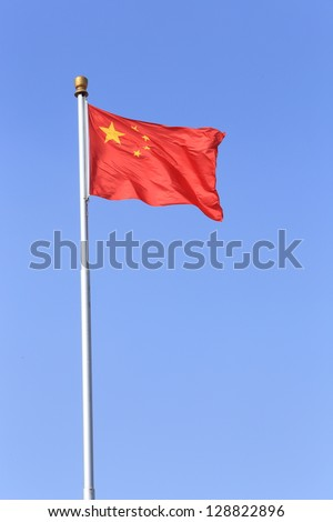 A red china flag in the wind - stock photo