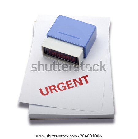 A red color Urgent rubber stamp on memo pad, isolated on white b