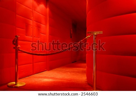 A red corridor to the stage in a theater - stock photo