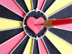 Free bullseye stock photos a red dart arrow hitting on heart shaped at bullseye of dartboard for reaching target thecheapjerseys Images