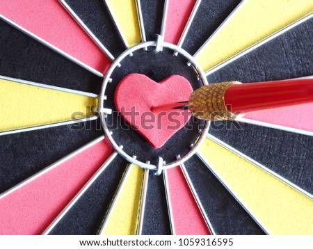Red dart arrow hitting on heart stock photo royalty free a red dart arrow hitting on heart shaped at bullseye of dartboard for reaching target altavistaventures Image collections