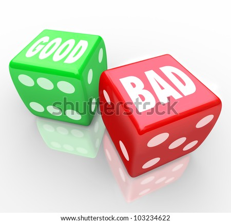 A red dice with the word Bad and a green die with the word Good for you to roll and determine the outcome of a game or situation, will the answer be positive or negative - stock photo