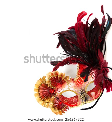 A red, elaborate mardi gras or venetian mask with feathers on a white background - stock photo