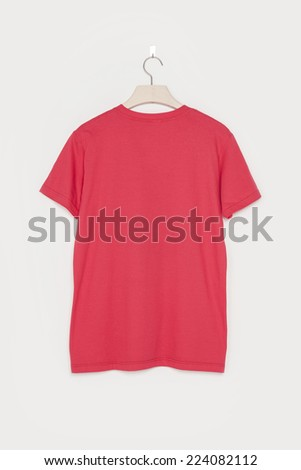 A red empty t-shirts back side with wooden hanger isolated white background. - stock photo