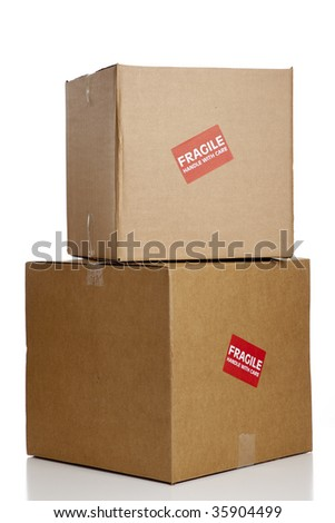 "A red ""Fragile"" sticker on a brown box with copy space - stock photo"