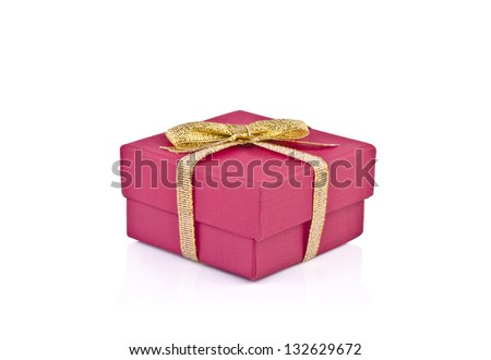 A red gift with a gold ribbon and a bow on white background.