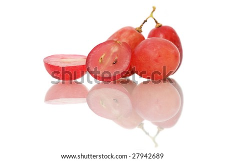 A red grape sliced into half isolated on white background.