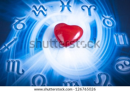 a red heart over blue zodiac background - stock photo