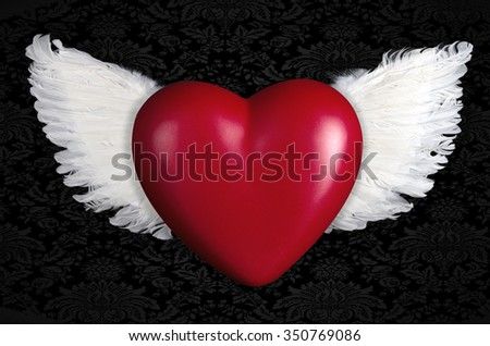A Red heart with angel wings - stock photo
