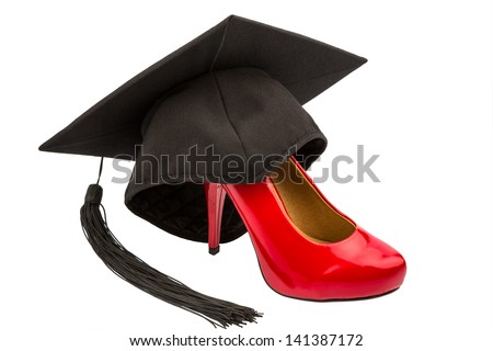 a red ladies shoes on a mortarboard symbol photo for gender equality and women power - stock photo