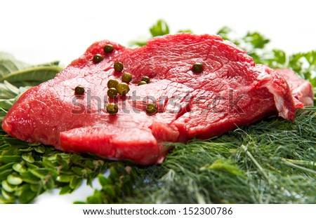 a red meat with sage and rosemary isolated on white background  - stock photo