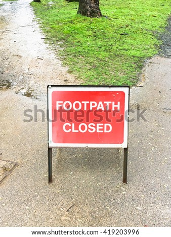 A red metal sign for a closed footpath - stock photo
