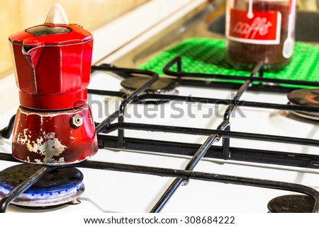 a red, old and real italian moka on fire - stock photo