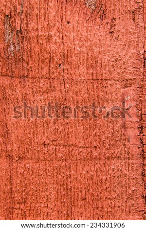 A red painted rough wooden siding board for use as texture - stock photo