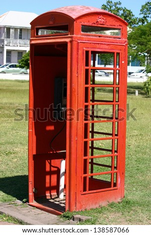 A red phone booth in Independence Square in St. Kitts, West Indies - stock photo