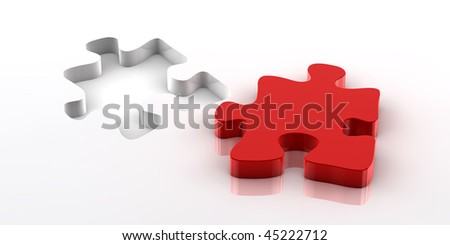 A red piece of a jigsaw puzzle fitting in the hole on the bottom - stock photo