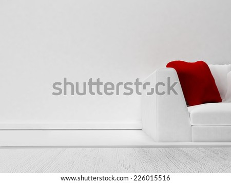 a red pillow on the sofa - stock photo