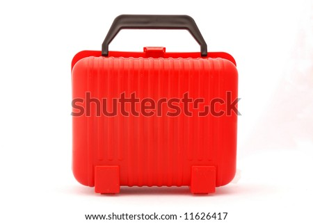 A red plastic suitcase for kids isolated on white background - stock photo