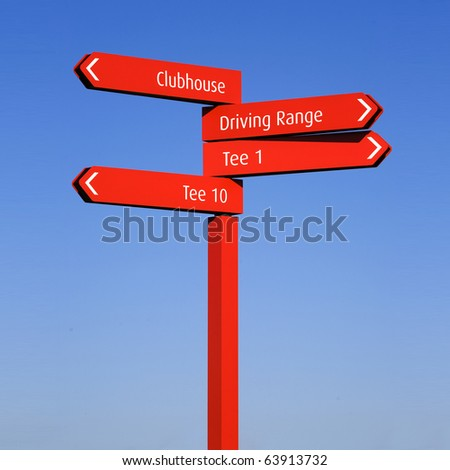 A red pole with sign arrows, pointing directions in a golf course: Tee, Clubhouse, Driving Range, over a clear blue sky - stock photo