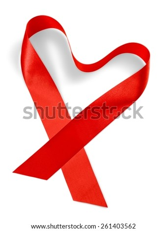 a red satin ribbon forming a heart and the sentence feliz dia de la madre, happy mothers day written in spanish - stock photo