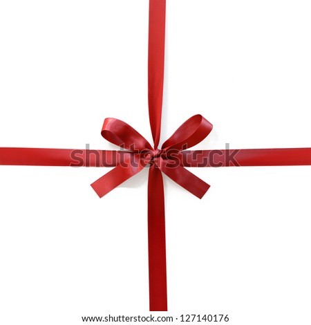 A red satin ribbon tied in a bow over a white background with soft shadow.