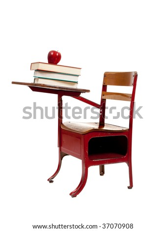 A red school desk with school books and an apple on white background with copy space - stock photo