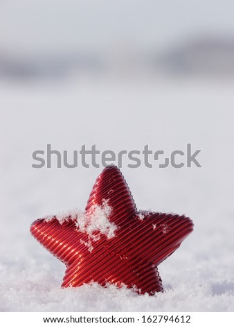 a red star in a winter landscape - stock photo